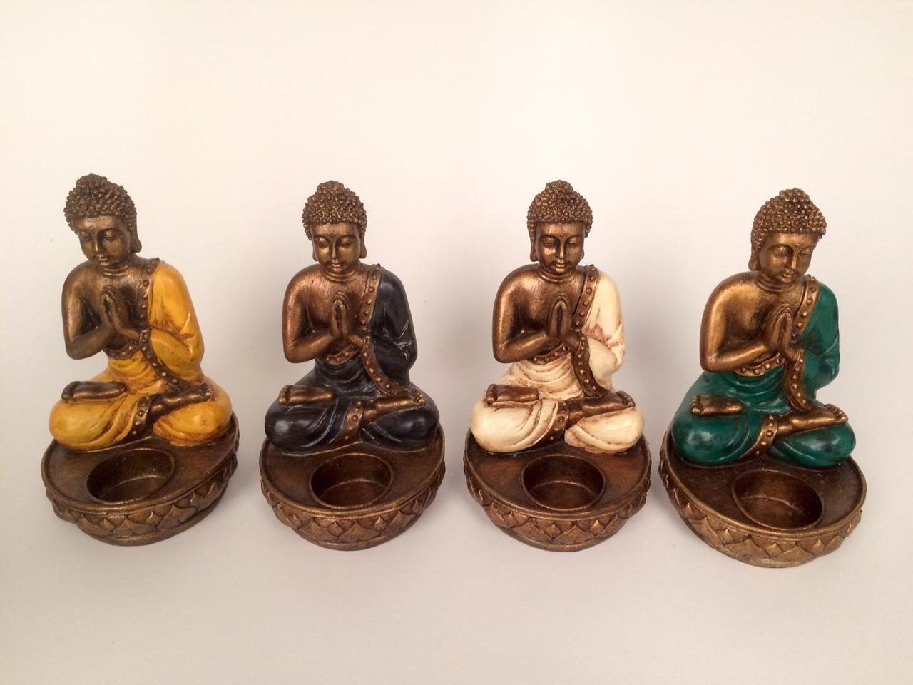 Biddend Buddha waxinelichtjeshouder. Handwerk Indonesië