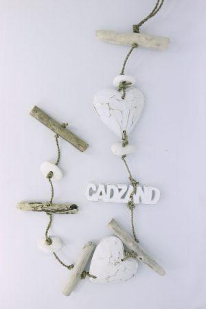 Guirlande met drijfhout en steentjes - Cadzand